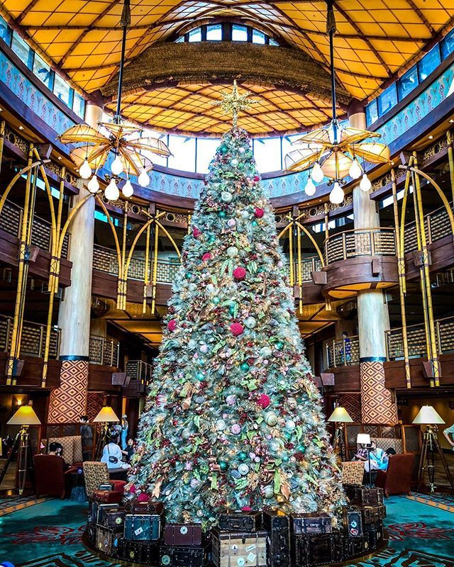 My Favorite Hotel Disney Explorers Lodge At Hong Kong Disneyland Has The Best Christmas Tree My Late Disney Hotels Cool Christmas Trees Hong Kong Disneyland