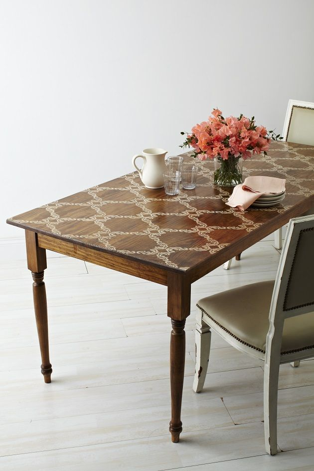 Step-by-step tutorial on how to stencil and stain a table. Such a beautiful look, and easy for beginners!