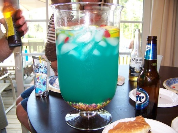 The Fishbowl Drink--  Fish Bowl (or improvise)   1/2 cup Nerds Candy   5 oz Vodka   5 oz Malibu Rum   3 oz Blue Curacao   6 oz Sweet  Sour Mix   16 oz Pineapple juice   16 oz Sprite   3 slices each Lime, Lemon, Orange   4 Swedish fish  Sounds good!  I have to try this one.