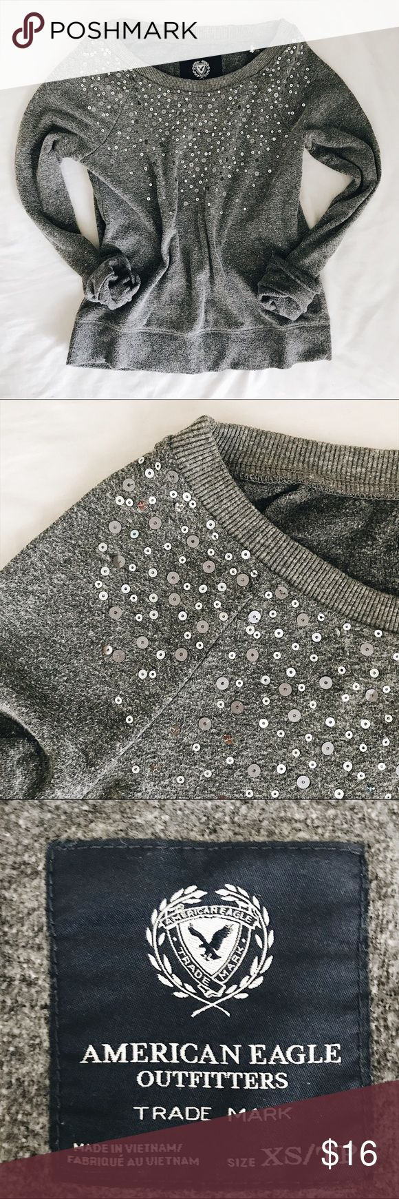 American Eagle Fleece Sequin Pullover Sweatshirt *CONSIDERING OFFERS! No trades.* Super cute and cozy heather grey pullover fleece sweatshirt from American Eagle Outfitters with silver sequins for added sparkle. In great condition and an awesome addition to any cozy girls wardrobe  American Eagle Outfitters Tops Sweatshirts & Hoodies