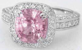 Oooh, pink sapphire... love the cushion cut!