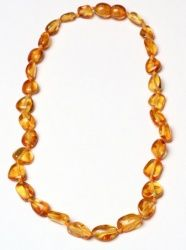 About $30 amber Necklace - Honey Beans Ella wore these around her wrist at first at about 4months old then around her neck and it has only come off once and we had the night from hell! We have 2 more teeth to go. Yes we had runny noses and high fevers with each tooth, but no ear aches, red dashed checks, dribbling, nappy rash or unusually irritability. This is something I'd do again. PS plenty of boys wear them too ;)