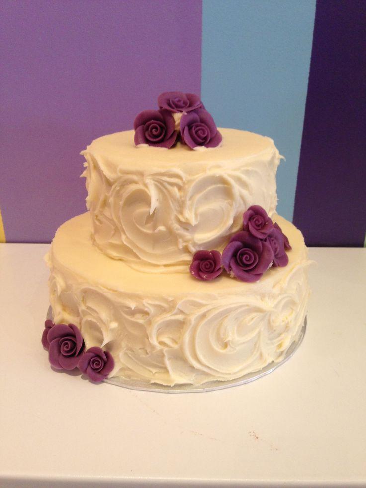 2 tier cake with dark purple roses