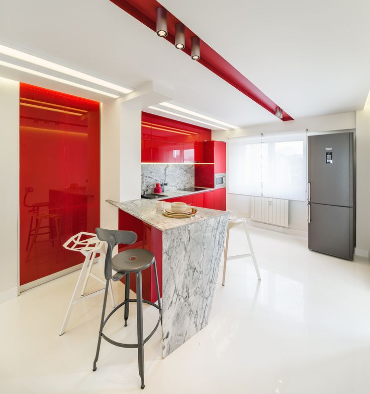 minimalist kitchen with marble countertop, fronts from glossy MDF in marsala color, push-to-open systems for door orders/price offers at: office@liniafurniture.ro