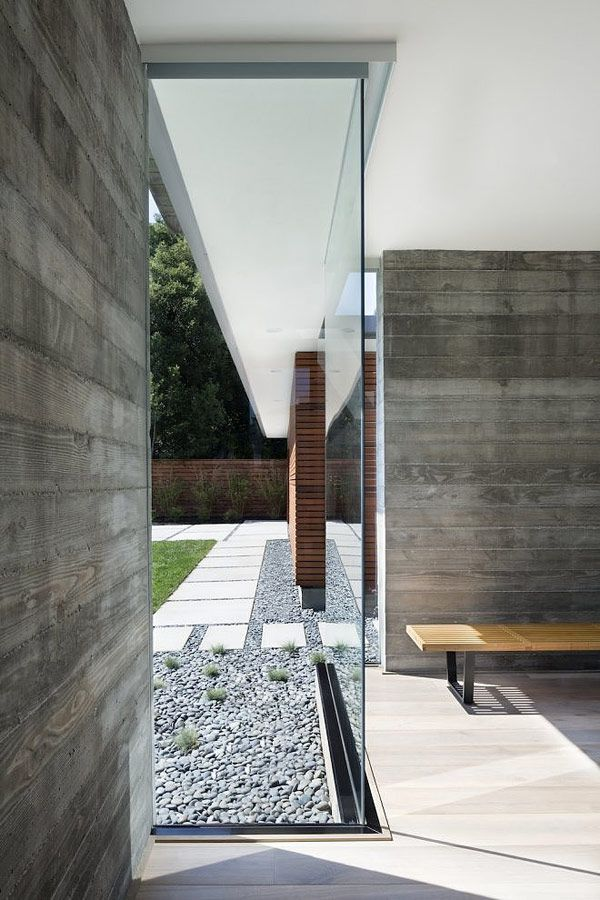 Minimalist House // corner glass and concrete detail at this modern house by Curt Cline of Modern House Architects