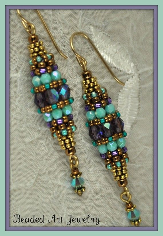 """Beaded Bead EarringsThese earrings are made using circular right angle weave to create a bead out of beads. They are made with Czech fire polish 4mm purple ab beads and 3mm Czech opaque turquiose luster, gold metallic Japanese seed beads, heishi and a Swarovski 4mm Turquoise ab crystal tassel on the end. They hang from a gold filled earring wire. They are 2 1/4"""" long and are 1/2"""" wide at the center"""