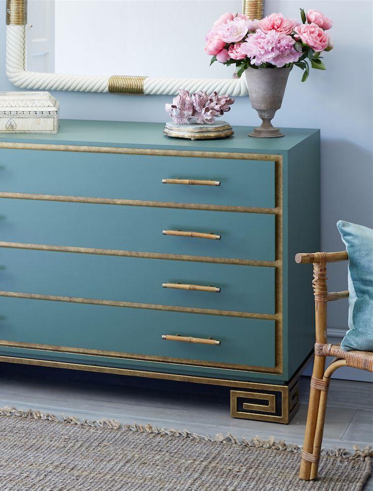 Love the gold Greek key detailing on the feet of this glamorous, modern bedroom dresser.