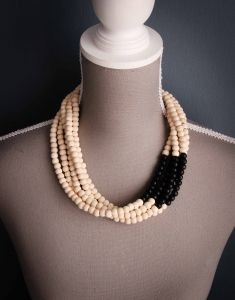 This Asymmetrical Color Block Wooden Ombre Necklace is a multi strand wooden necklace color blocked using natural and black beads. Sold by www.wave2africa.com