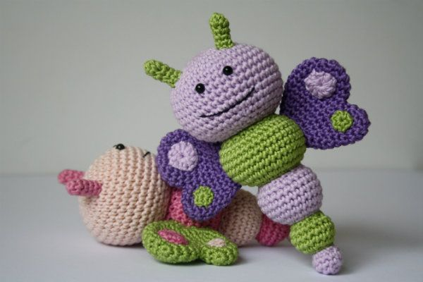 These colorful and smiley bug rattles will make any baby happy! They`re easy to make and bring a lot of joy. Pattern includes 3 bugs - sweet butterfly, friendly bee and nosy caterpillar. Bug rattles make a cute gift for the newborn. You can also hang them up to make a baby mobile.