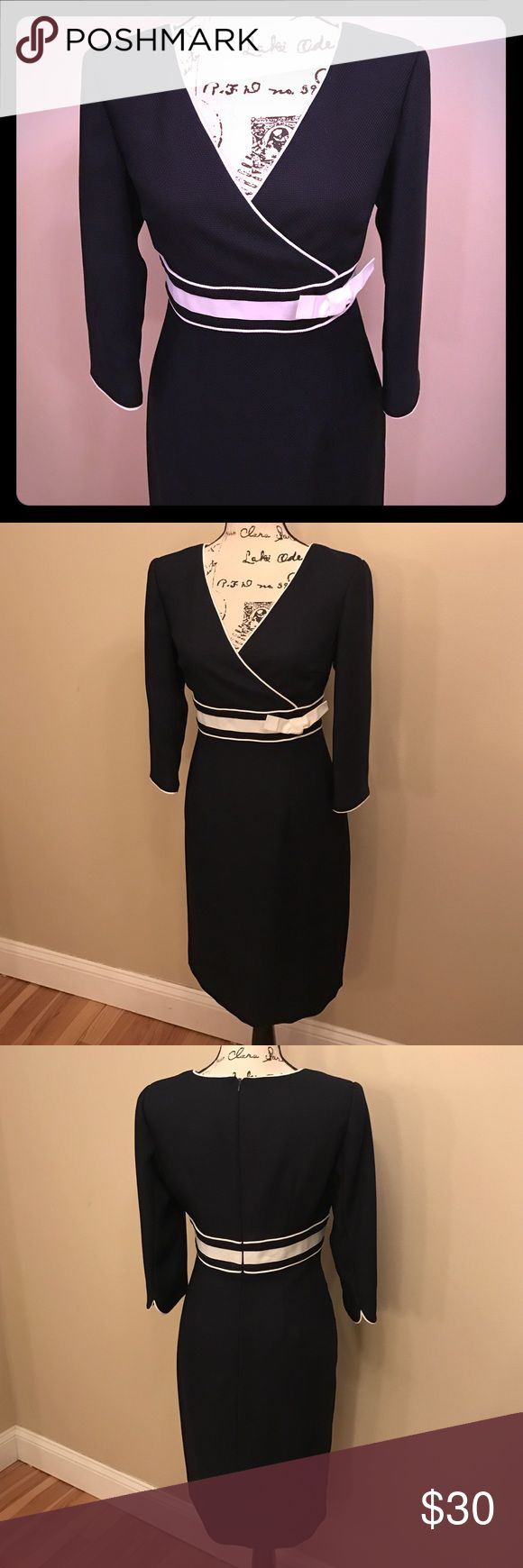 Navy 3/4 sleeve dress Navy 3/4 sleeve dress. White pipeing and band around the middle. V neck. Zipper up back. No stains or snags. Donna Morgan Dresses