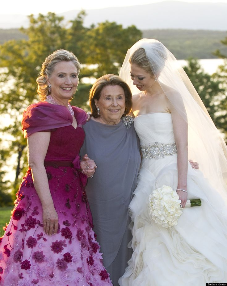 Hillary Clinton, her mother and Chelsea. Does Hillary own a mirror? Her dress is so ugly. Looks like she is trying to be the main attraction. Her mother and Chelsea look lovely.