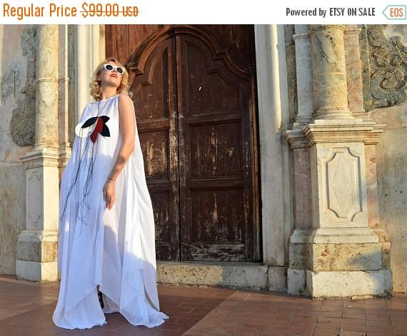 Extravagant white long kaftan, asymmetrical, sheer and vaporous made for the beautiful princess in you! This white long summer dress comes with an underneath viscose dress. Two pieces for this item! *white royal kaftan from the La Dolce Vita Collection  Material: 100% chiffon, polyester - cover kaftan / 95% viscose, 5% elastane - underneath dress  Care instructions: Wash at 30 degrees  The model in the picture is size S.  Can be made in ALL SIZES.  If you have any other specific requirem...