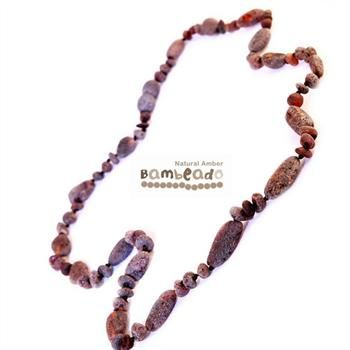 Wearing this necklace for guys might assist with well being and general aches and pains. A gorgeous combination piece with alternating bean shaped and round beads in dark and charcoal colour. This amber necklace is approx 47 cm in length and the beads are not highly polished giving a rustic surfy look. Great for the guys!
