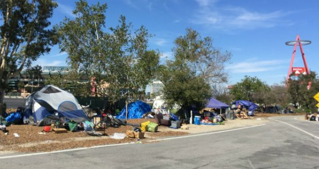 County Partners With City Net To Entice Homeless Out Of Santa Ana River Camps