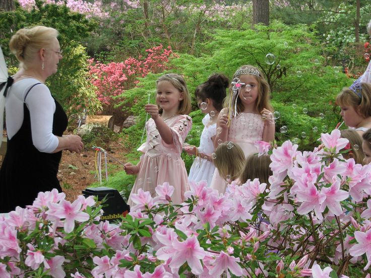 Kids in fairy outfits blowing bubbles. Pagan inspired bday party for girls or a ritual