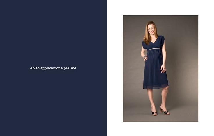 Sarebbe un abito premaman, ma io *adoro* i vestiti premaman di questa marca... :-\