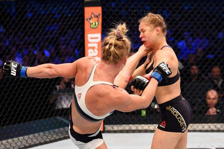 MELBOURNE, Australia — Holly Holm pulled off a stunning upset victory over Ronda Rousey in UFC 193, knocking out the women's bantamweight champion in the second round with a powerful kick to the he...