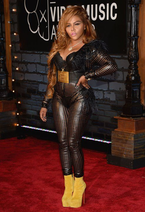 Lil Kim attends the 2013 MTV Video Music Awards...IWe think we spy some Ostrich Fringe up in there...!