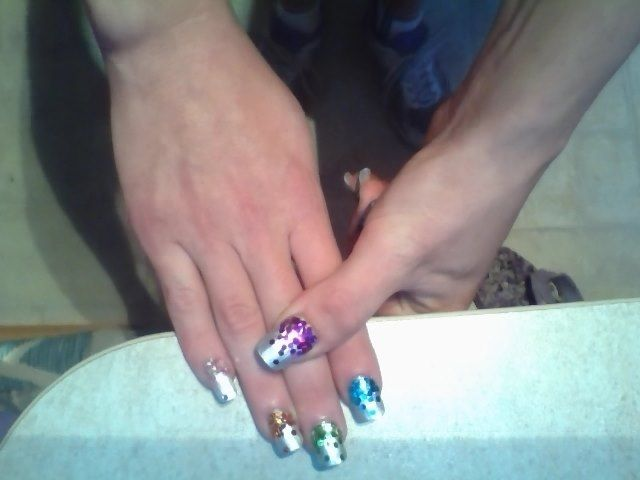 falling glitter, gel nails , silver nail polish both small and large glitters