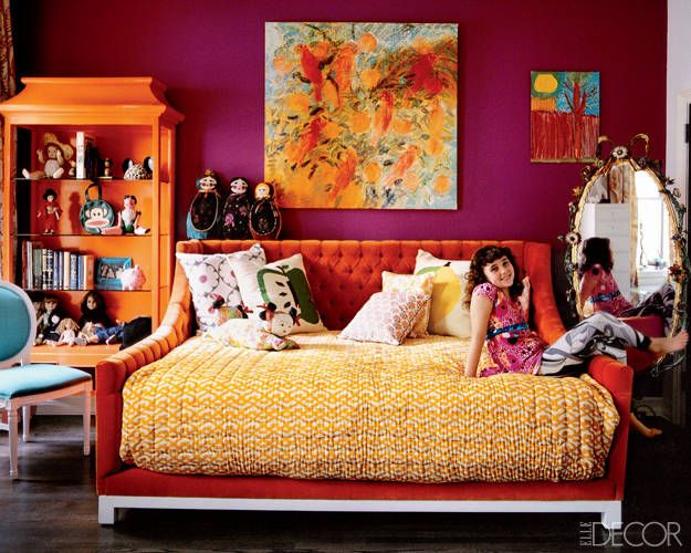 Red/purple walls with orange accent wall, light blue desk and closet.. I love everything.. especially the bed!!
