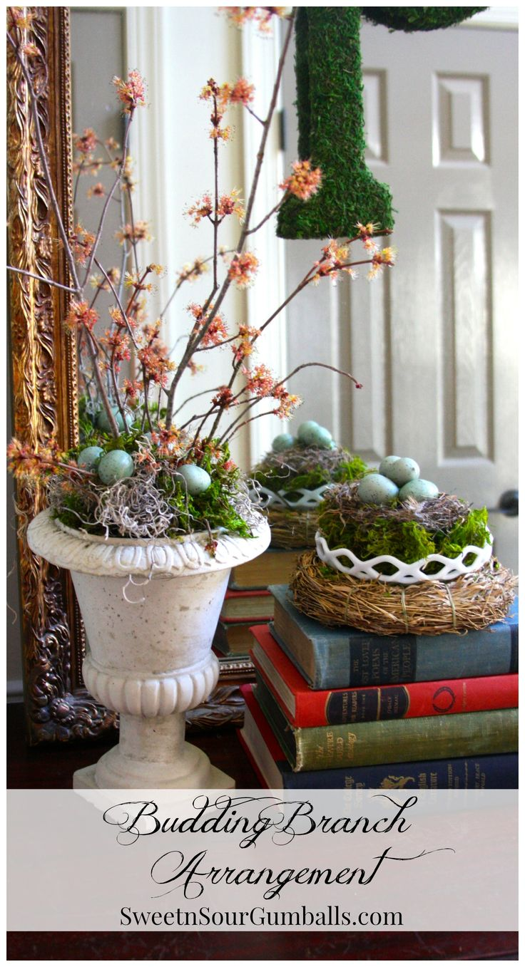 Spring floral arrangement with budding branches share
