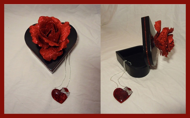 Black heart-Shaped gift-box.  Gorgeous glittering red rose on top & red shining rhinestones on the side.  Makes a great box to hold that special gift for Mother's Day, Valentine's or Anniversary gift.     Available with or without heart pendant necklace.