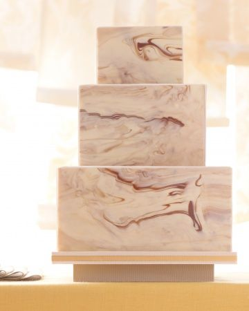 Marbled Wedding Cake: It looks like a chiseled sculpture but this three-tiered confection is actually paneled in bars of chocolate made by Mary Matson for Chocolate Editions. —Martha Stewart Weddings