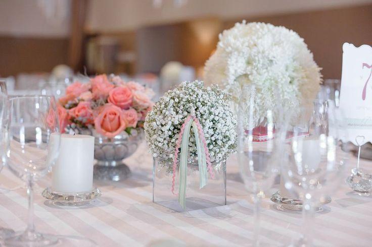 Flower balls of coral roses / baby's breathe / single white pom poms