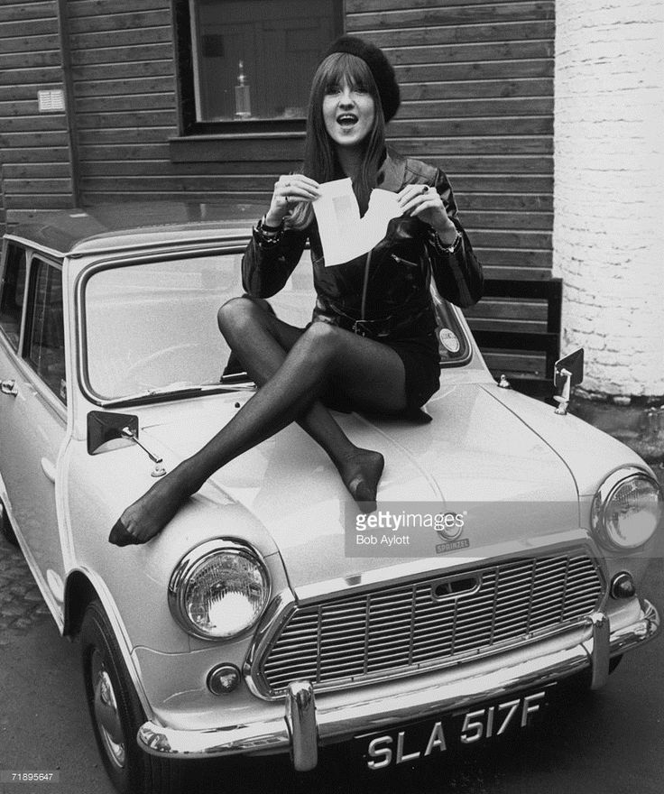 Cathy McGowan, presenter of the TV pop programme 'Ready Steady Go', tears up her 'L' plate after passing her driving test at the first attempt, 19th January 1968. She is sitting on the bonnet of her new Mini deluxe automatic, purchased from John Sprinzel's garage in Lancaster Mews at a cost of £672.