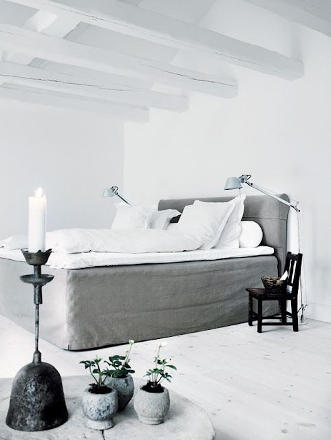 simple black and white bedroom with whitewashed wooden floor