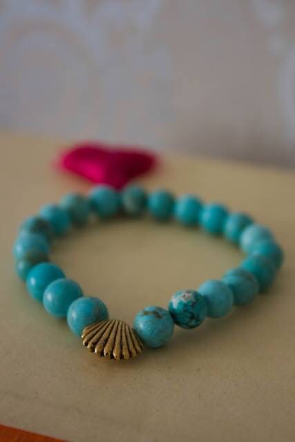 Yoga bracelets turquoise howlite with vintage Shell charms and dark fuchsia  sari silk tassel