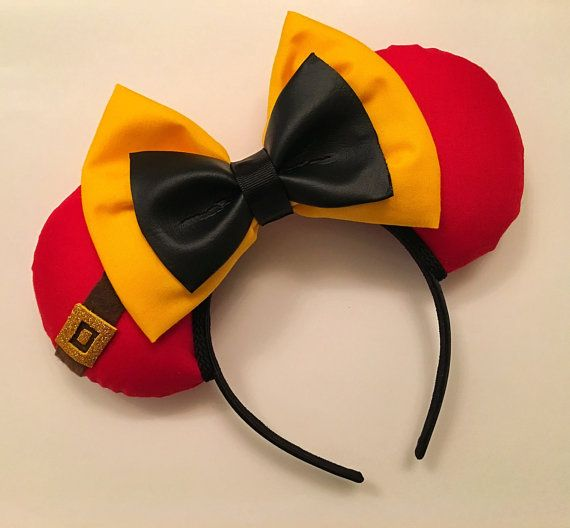 These Gaston inspired Mickey ears are made with red fabric, trimmed in black with a double bow of yellow and pleather. All ears are handmade and made to order. Each pair of ears is high quality, as I spend a great deal of time on each individual pair. Print placement and accessories may vary slightly from the item pictured, however, every effort will be made to duplicate the item as pictured. The headband used for all ears fits most children and adults (this headband is very comfortable and…