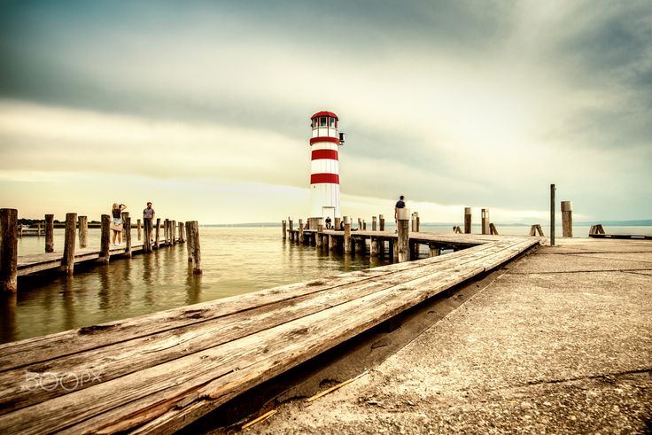 Lighthouse at the lake - View to the piers at the Neusiedler See with its famous lighthouse in Podersdorf am See in Austria.