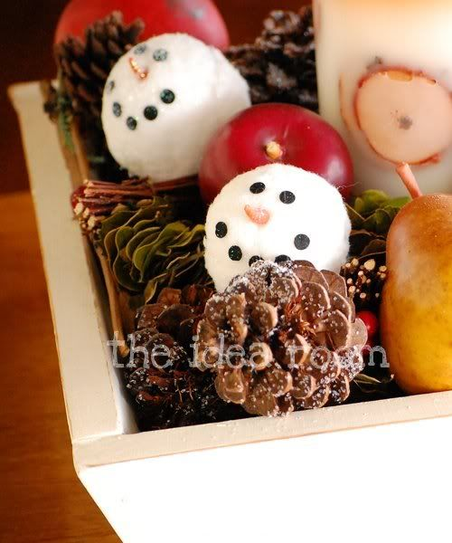 She shows you how to make these cute snowmen... Great Idea for next year...love snowmen.