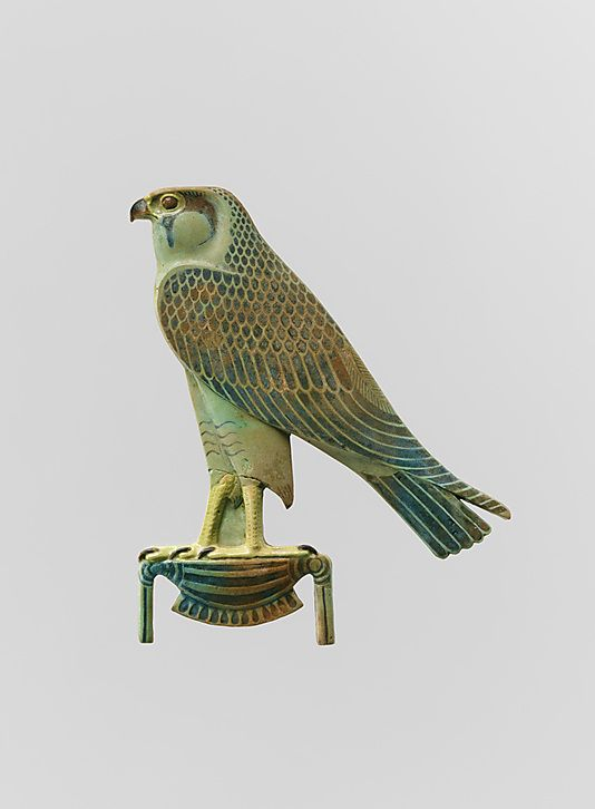 A fourth-century BC ancient Egyptian faience inlay depicting 'Horus of gold', the falcon symbolises the sky god Horus; it perches on the hieroglyph for 'gold'. (Metropolitan Museum of Art)