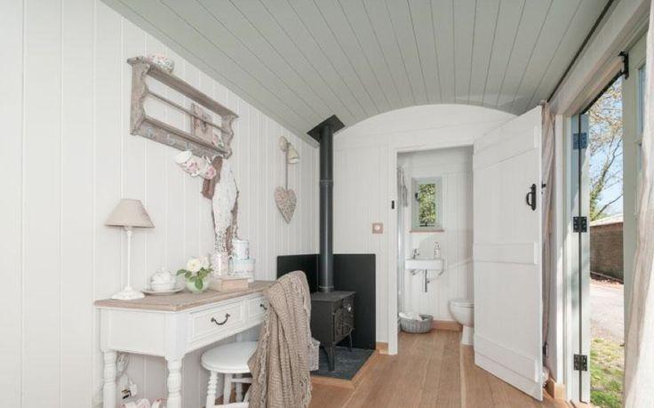 Beautiful interior of a luxury shepherds hut white shabby for Luxury garden office