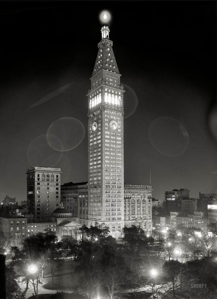 New York City circa 1910. Metropolitan Life Insurance Company building at night. Note the 10-minute exposure time as recorded by the clock. 8x10 inch dry plate glass negative, Detroit Publishing Company.
