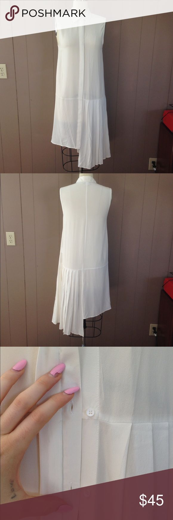 OAK NYC sheer chiffon button down dress NWOT never worn OAK NYC asymmetrical button down dress. Could be worn with leggings or as a layering piece! Two small marks on back are the only defects. Feel free to ask questions or MAKE AN OFFER! oak nyc Dresses Asymmetrical