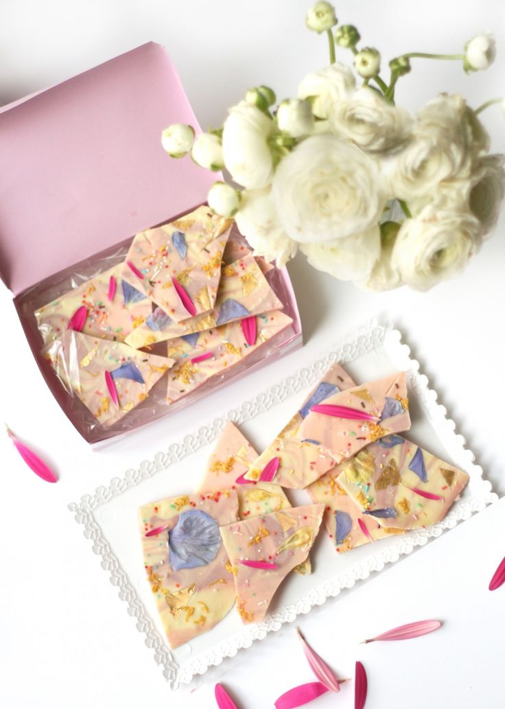 White Chocolate Bark with edible flowers, gold leaf, and sprinkles.