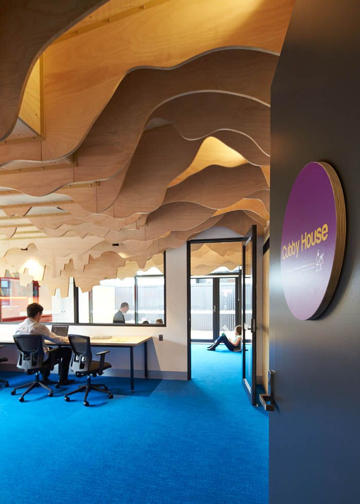 Entrance into the office and children's spaces at the Cubbyhouse in Broadmeadows Children's Court with an up-side-down cityscape ceiling sculpted out of timber fins | Cubbyhouse by Mihaly Slocombe (2014-15) | Broadmeadows, Victoria, Australia | Photo: Peter Bennetts