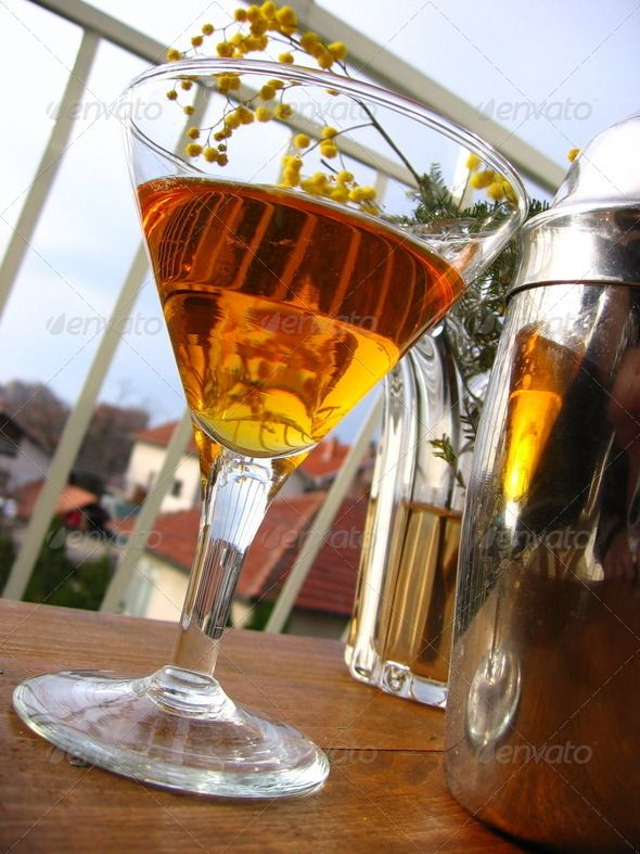Mandarin Martini (Vertical) ...  Mandarin, alcohol, alcoholic, bar, bartender, bartending, brown, club, cocktail, color, delicious, drink, drinking, gin, glass, leisure, liqueur, liquor, martini, metal, metallic, mimose, night club, nightclub, orange, outdoor, outdoors, served, shaker, sweet, tangerine, tasty, vodka, wood