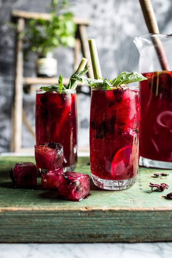 Make honey-sweetened hibiscus, lemongrass, and basil tea even more appealing with edible-flower–embedded ice cubes.