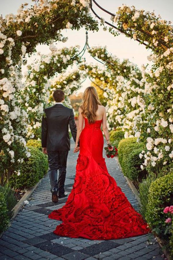 A red wedding dress is perfect for a winter wedding. It is also perfect for a sexy and elegant bride wanting to make a splash at her wedding.