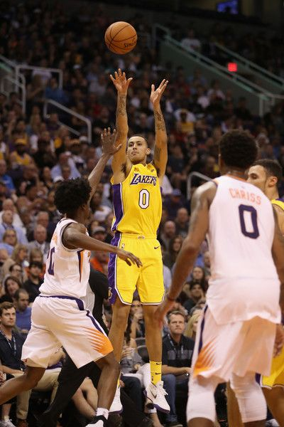 256d1d23c0a Kyle Kuzma Photos - Kyle Kuzma  0 of the Los Angeles Lakers attempts a shot  against the Phoenix Suns during the NBA game at Talking Stick Resort Arena  on ...
