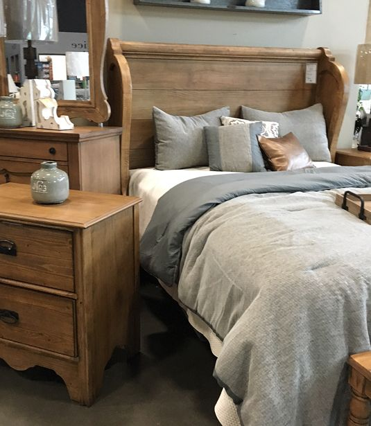 Church pew headboard bed from Magnolia Home by Joanna Gaines. At Toms-Price Furniture.