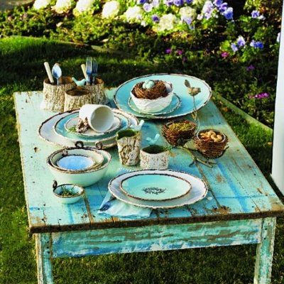 so breakfast at tiffanys as a pun, but not glamorous, country. blue mason jars, antique blue plates, blue washed stuff if we cant find furniture. I like this robin egg idea, turns it more country