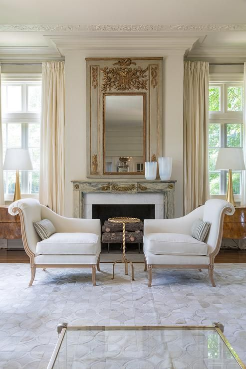 French living room features two piece, separated French chaise lounge flanking a gold rope accent ...