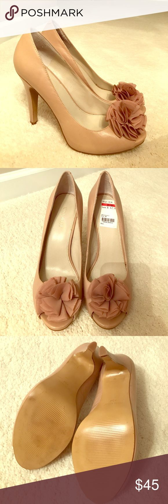 Nine West: Nude Peep Toe Pumps Never been worn.  Beautiful new peep toe pumps. Great for dressing up any outfit! Nine West Shoes Heels