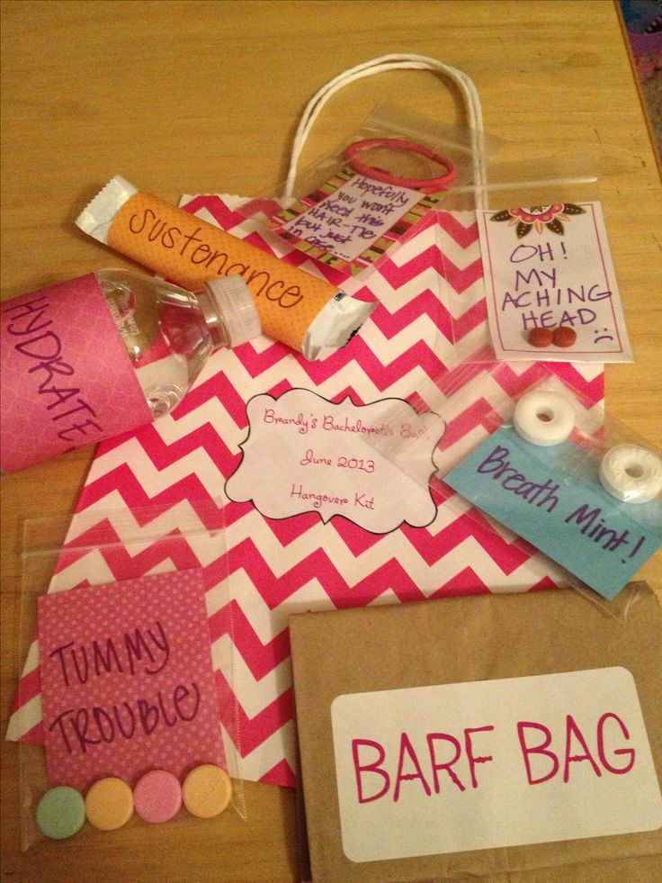 """Hangover Kit"" party favor bags I made for my future sister in law's bachelorette party. I used every day items such as breath mints, tums, Advil, water, granola bars, ponytail holders and brown paper bags (labeled barf bag). Placed small items in jewelry bags from Hobby Lobby with cute sayings written on scrapbook paper. Wrapped the granola and water in cute scrapbook paper. Placed all items in cute chevron bags that came in a pack of 12 at Hobby Lobby."