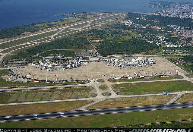 Overview of Rio de Janeiro - Galeao International Airport ramp and both passengers terminals. Terminal 1 on the left, terminal 2 on the right, the administration building in the middle of both terminals and TAP-ME hangar on the top part of the picture. Today there are many works going on to enlarge the ramp and build new terminals. Courtesy: www.airliners.net